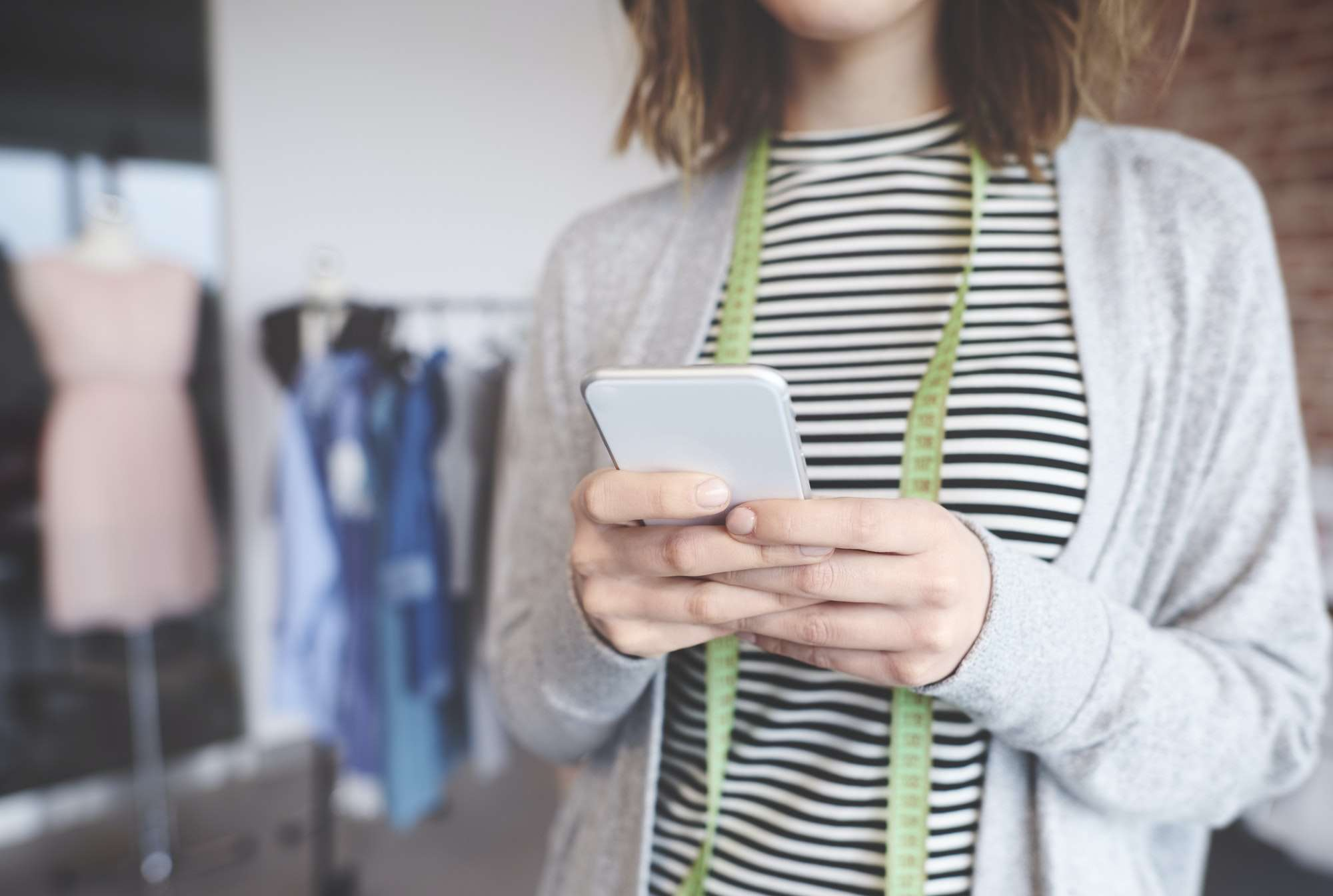 Small business owner text messaging