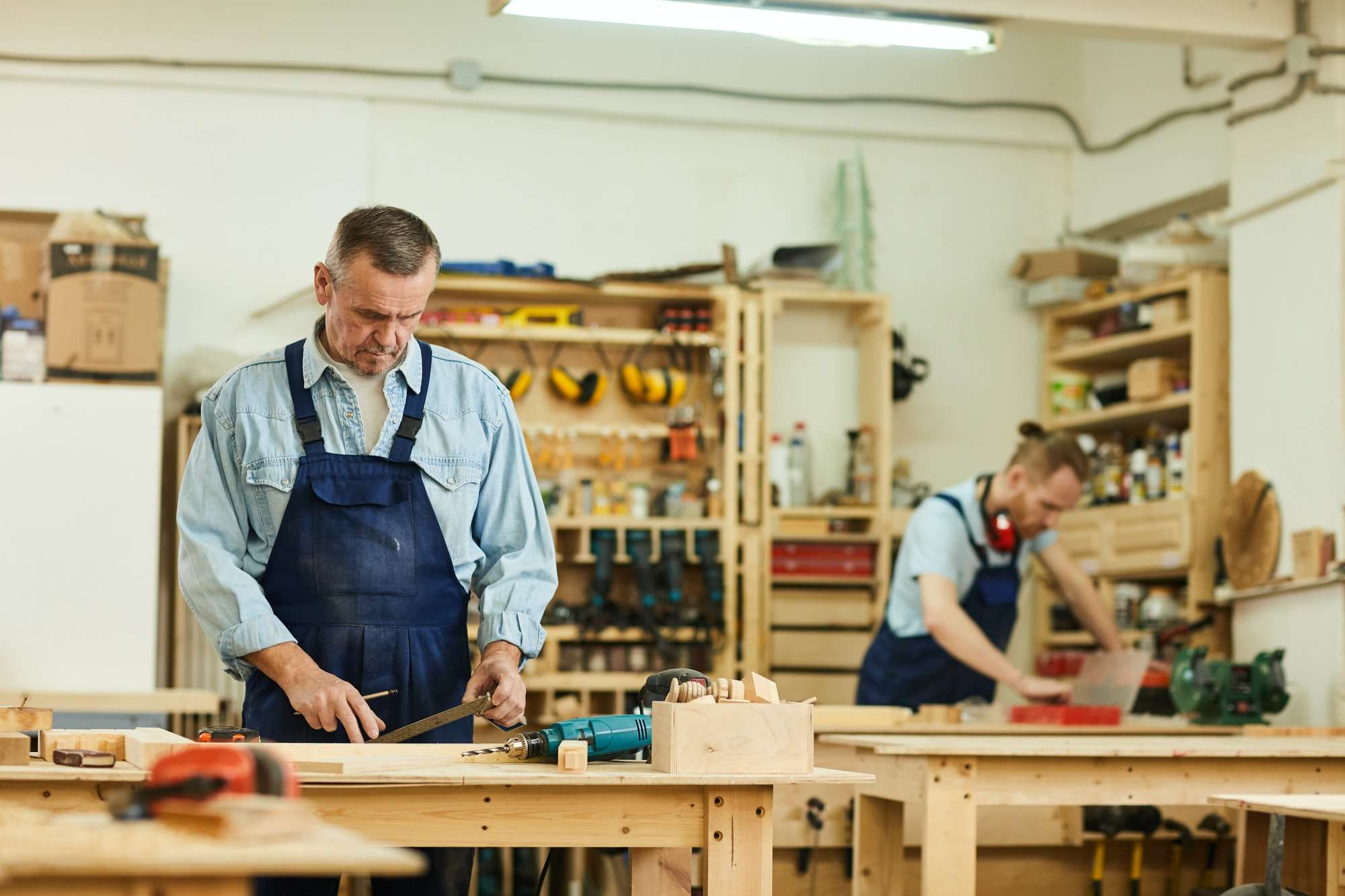 Carpenters Assembling Furniture