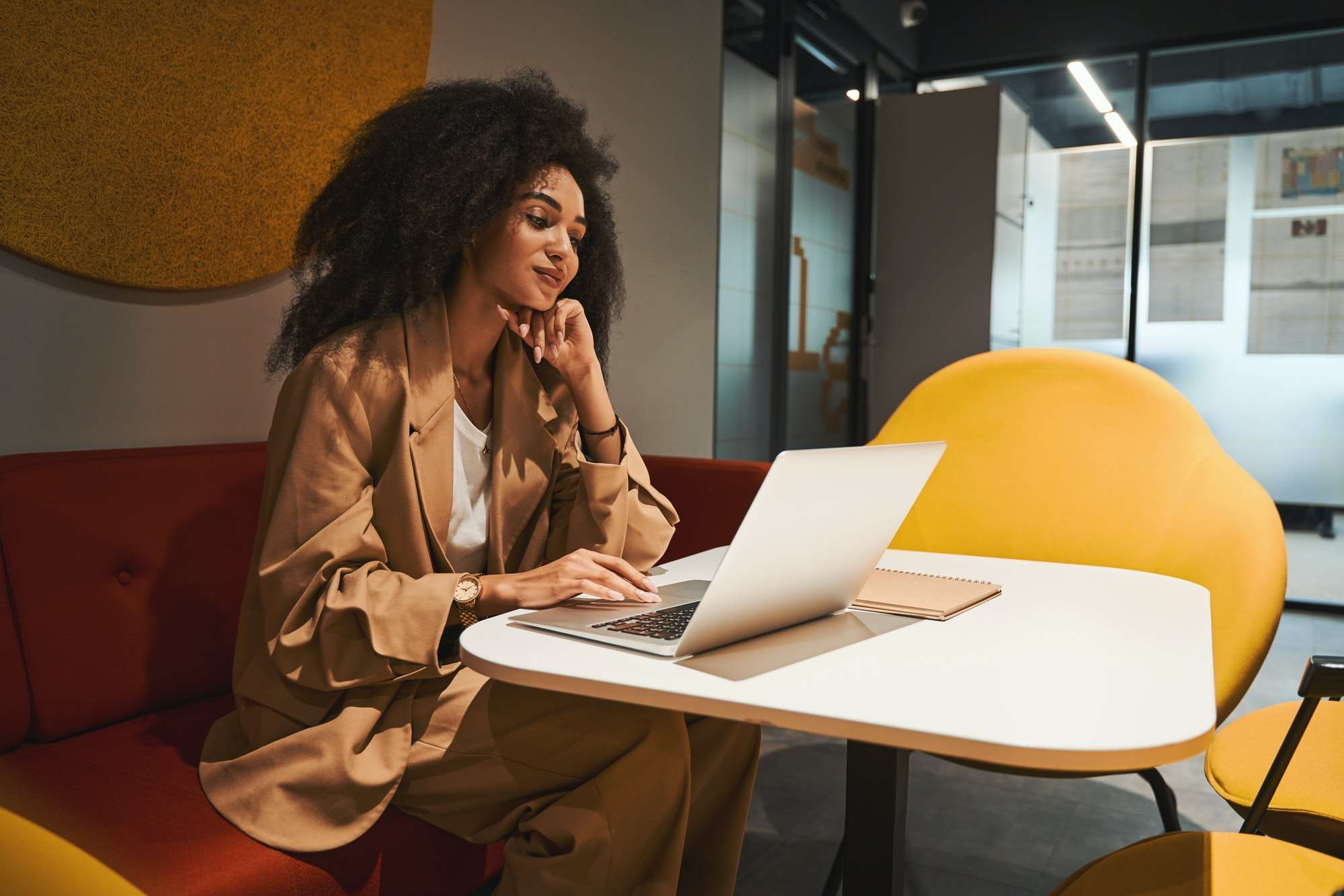 Confident employee working online in coworking center